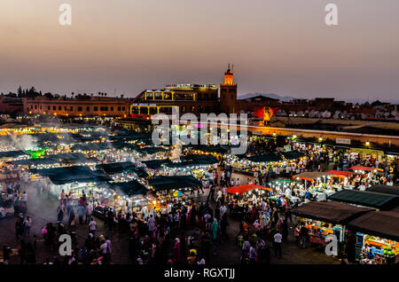 Evening scene at popular Jamaa el-Fnaa- The popular tourist Square  in Marrakesh, Morocco - Stock Photo