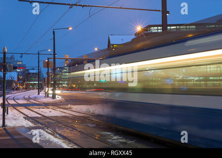Tram in Motion Blur in Winter in Zurich, Switzerland. - Stock Photo