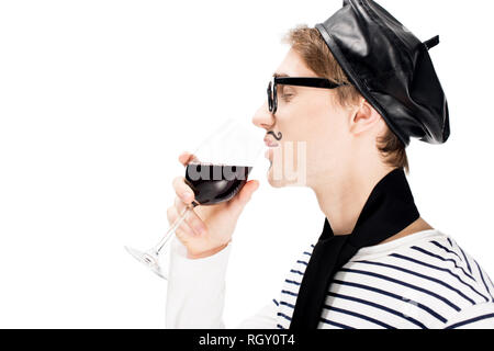 side view of happy french man holding glass of wine and drinking with closed eyes isolated on white - Stock Photo