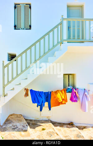 Airing clothes under staircase in the street in Mykonos island, Greece - Stock Photo