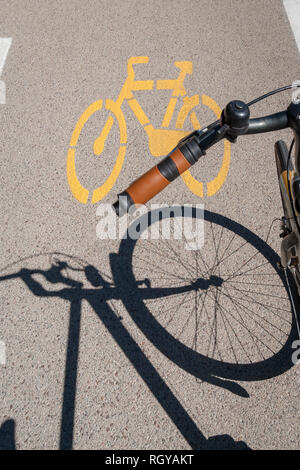 Bicycle sign painted on road surface - Stock Photo