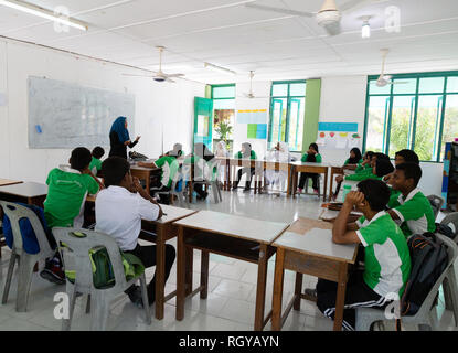 Maldives school - muslim secondary schoolchildren in the classroom, Ukulhas Island, the Maldives, Asia - Stock Photo