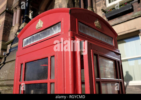 Traditional British Telecom Red Telephone Box, St Helens, UK - Stock Photo