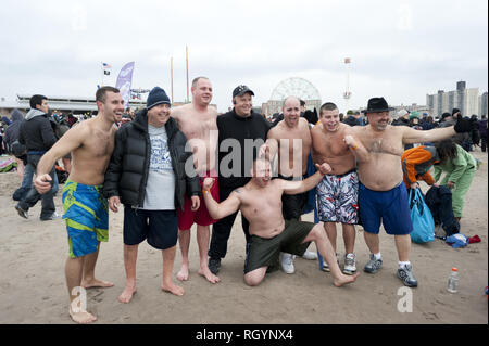 Annual Polar Bear Club New Year's Day plunge into Atlantic Ocean at Coney Island in Brooklyn, NY, Jan.1, 2013. An estimated 2,000 revelers and swimmer - Stock Photo