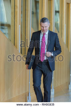 Edinburgh, UK. 31st January, 2019.  Finance Secretary Derek MacKay on his way to attend First Ministers Questions before presenting Stage One of his 2019 Budget for debate later in the day. Credit: Roger Gaisford/Alamy Live News. - Stock Photo