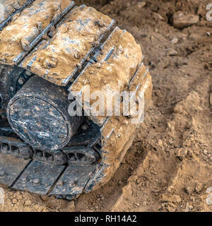 Excavator track pad and tread mark on dirt - Stock Photo