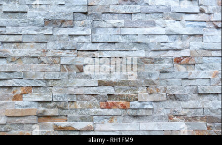 Stone wall of rough elongated facing stones - Stock Photo