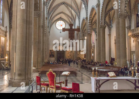 Italy, Florence - April 02 2017: the view of the Nave with the Crucifix of Giotto inside of Santa Maria Novella Church on April 02 2017, Tuscany. - Stock Photo