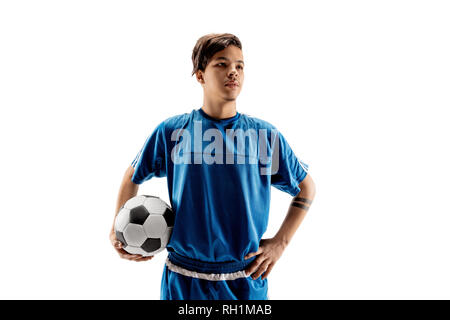 Young fit boy with soccer ball standing isolated on white. The football soccer player on studio background. - Stock Photo