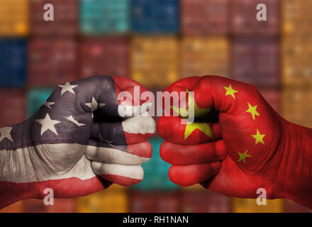 USA and China Chinese fist competing in an economic business trade war battle with shipping containers in the background. The image uses US and China  - Stock Photo