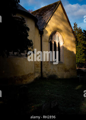 Portrait English village church in early morning sunlight - Stock Photo