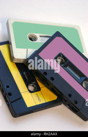 three vintage audio tapes on white background with color labels - Stock Photo