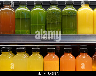 Bottles of freshly squeezed fruit and vegetable juces for sale in a grocery store, Vancouver, BC, Canada - Stock Photo