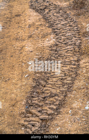 Tire tracks on dried mud in Utah Valley - Stock Photo