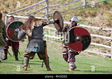 Battle re-enactment between vikings and Saxons at Castle Rising's 'Soldiers Through the Ages' event in Norfolk, England. - Stock Photo