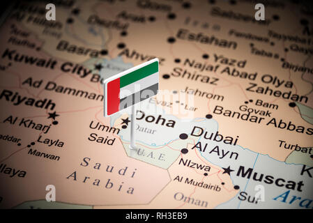 United Arab Emirates marked with a flag on the map - Stock Photo