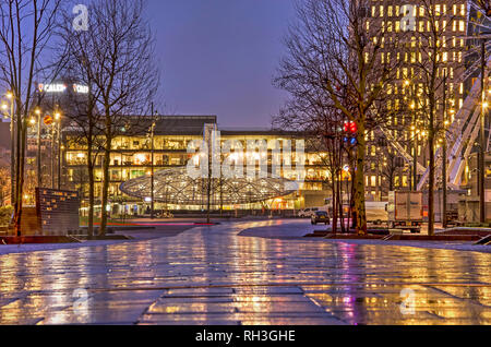 Rotterdam, The Netherlands, January 11, 2019:  view along Binnenrotte market square towards Blaak railway station on a rainy morning in the blue hour - Stock Photo