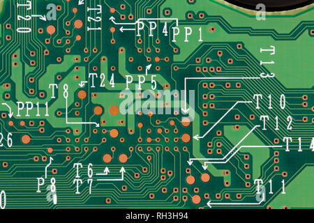Closeup of green printed computer circuit boards. Electronic computer hardware technology. Top view. - Stock Photo