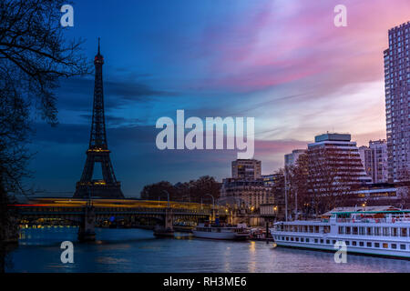 Night to Day over Eiffel tower in winter - Paris - Stock Photo