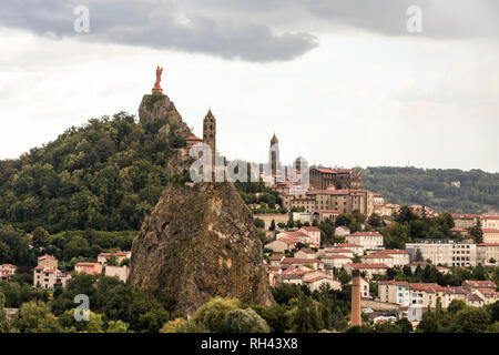 Le Puy-en-Velay, France. Views of the Cathedral of Notre-Dame, the Saint Michel d'Aiguilhe Chapel, and the statue of Notre-Dame de France - Stock Photo