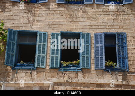 Blue wooden shutters at windows on a building in the old town of Jaffa in Tel Aviv, Israel - Stock Photo