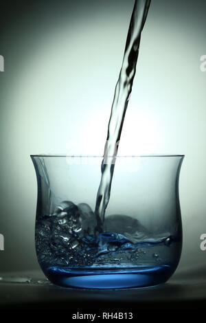 Oil poured into fine highball glass - Stock Photo