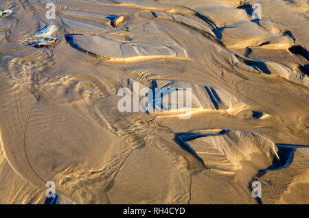 Patterns in the sand left by an ebbing tide on the beach at West Runton, Norfolk, England, United Kingdom, Europe. - Stock Photo
