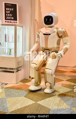 Ubtech's humanoid robot, Walker, demonstrates robotic skills at exhibit booth at CES, world's largest electronics trade show, Las Vegas, USA - Stock Photo