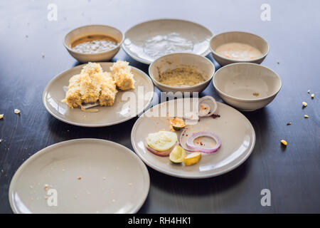 Plates with crumbs of food. Remains of food in plates after lunch or dinner - Stock Photo