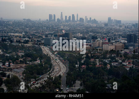 Overview of Hollywood  and downtown Los Angeles in distance.at sunset. - Stock Photo
