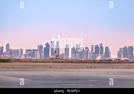 Doha skyline. Cityscape of Qatar capital. View from airport. Futuristic urban landscape of Doha. - Stock Photo
