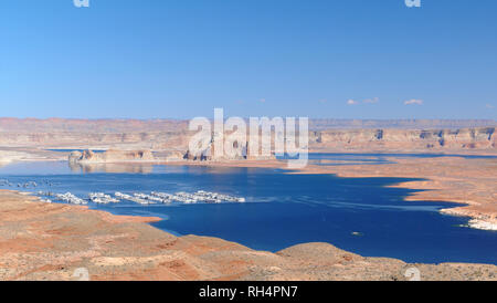 Lake Powell in Arizona, USA. Overview of the artificial reservoir of Lake Powell, on the Colorado River. Marina with boats on the lake - Stock Photo