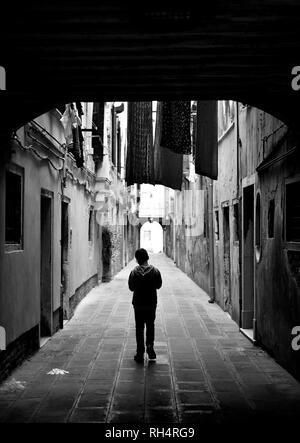 Young boy on a calle in Venice - Stock Photo