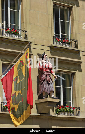 The statue of the butcher decorates frontage of a building in the old town of Bern, Switzerland - Stock Photo