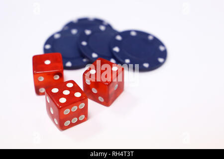 Red dice and casino gaming chips isolated on white. Background for gambling, luck, casino games - Stock Photo