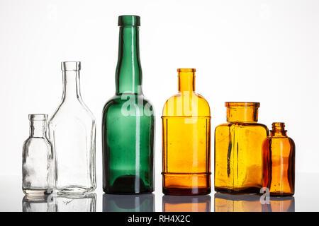 Group of old medicine bottles. Vintage Drugstore or pharmacy bottles on White background - Stock Photo