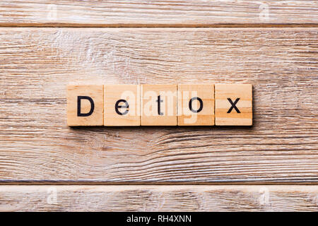 detox word written on wood block. detox text on wooden table for your desing, concept. - Stock Photo