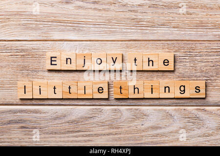 Enjoy the little things word written on wood block. Enjoy the little things text on wooden table for your desing, concept. - Stock Photo