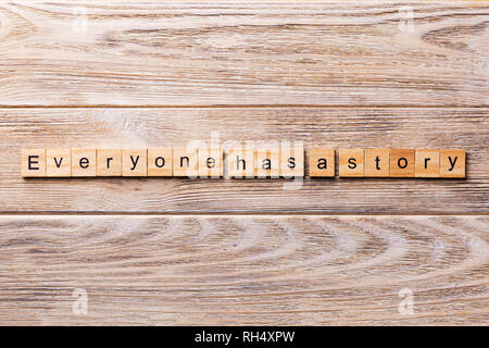 Everyone Has a Story word written on wood block. Everyone Has a Story text on wooden table for your desing, concept. - Stock Photo