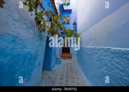 Beautiful view of the blue city CHEFCHAOUEN, MOROCCO in the medina. Traditional moroccan architectural details and painted houses and door - Stock Photo