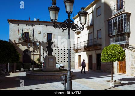 Castellar, Jaen province, Andalusia, Spain : A man walks past the town hall placed at the Palacio de la Casa Ducal de Medinaceli in Plaza de la Consti - Stock Photo