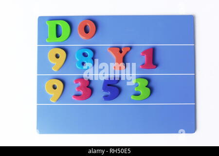 plastic magnetic colored english alphabet on blue background - Stock Photo