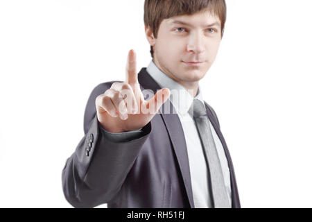 close up. businessman presses his finger on the virtual point.isolated on grey background - Stock Photo
