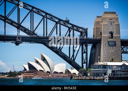 Looking under Sydney Harbour Bridge to Sydney Opera House in Sydney, NSW, Australia on 7 January 2015 - Stock Photo