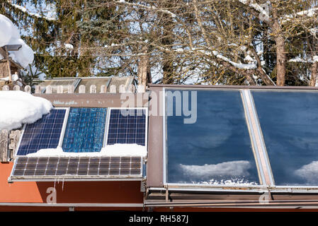 Solar panel, photovoltaic panels PV on a house roof. Electricity from the sun. House in the mountains. - Stock Photo