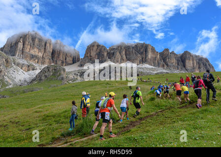 Participants in the Dolomites Skyrace running up the Sella Massif - Stock Photo