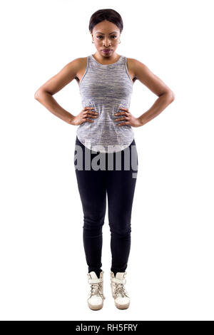 Angry black female wearing athletic outfit on a white background as a fitness trainer - Stock Photo
