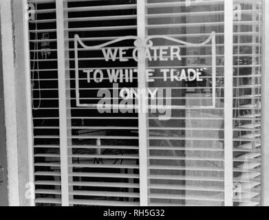 Sign on a restaurant: 'We Cater to White Trade only.', taken in Lancaster, Ohio, August 1938 - Stock Photo