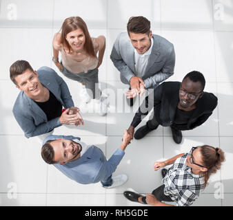 Top view of multiracial young creative people in modern office - Stock Photo
