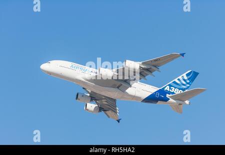 DUBAI, UAE - NOVEMBER 11, 2007: An Airbus A380 flying at low altitude over Dubai in the United Arab Emirates. - Stock Photo